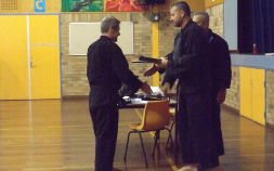 Martial artist being awarded black belt