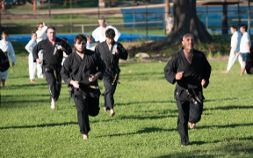 Martial artist training cardio at park training session outdoor